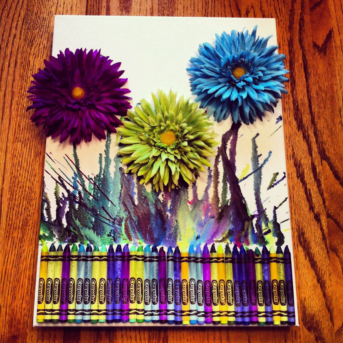 Melted crayon art with flowers done with brighter colors for How to melt crayons on canvas