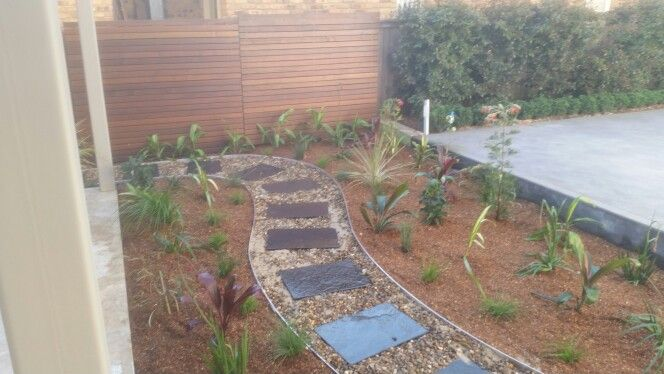Designed and constructed by king of the garden landscape solutions. Dry river bed walk way.