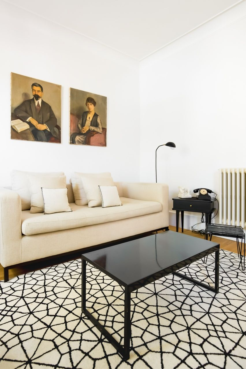 Living room, cream couch, white couch, rug, vintage telephone ...