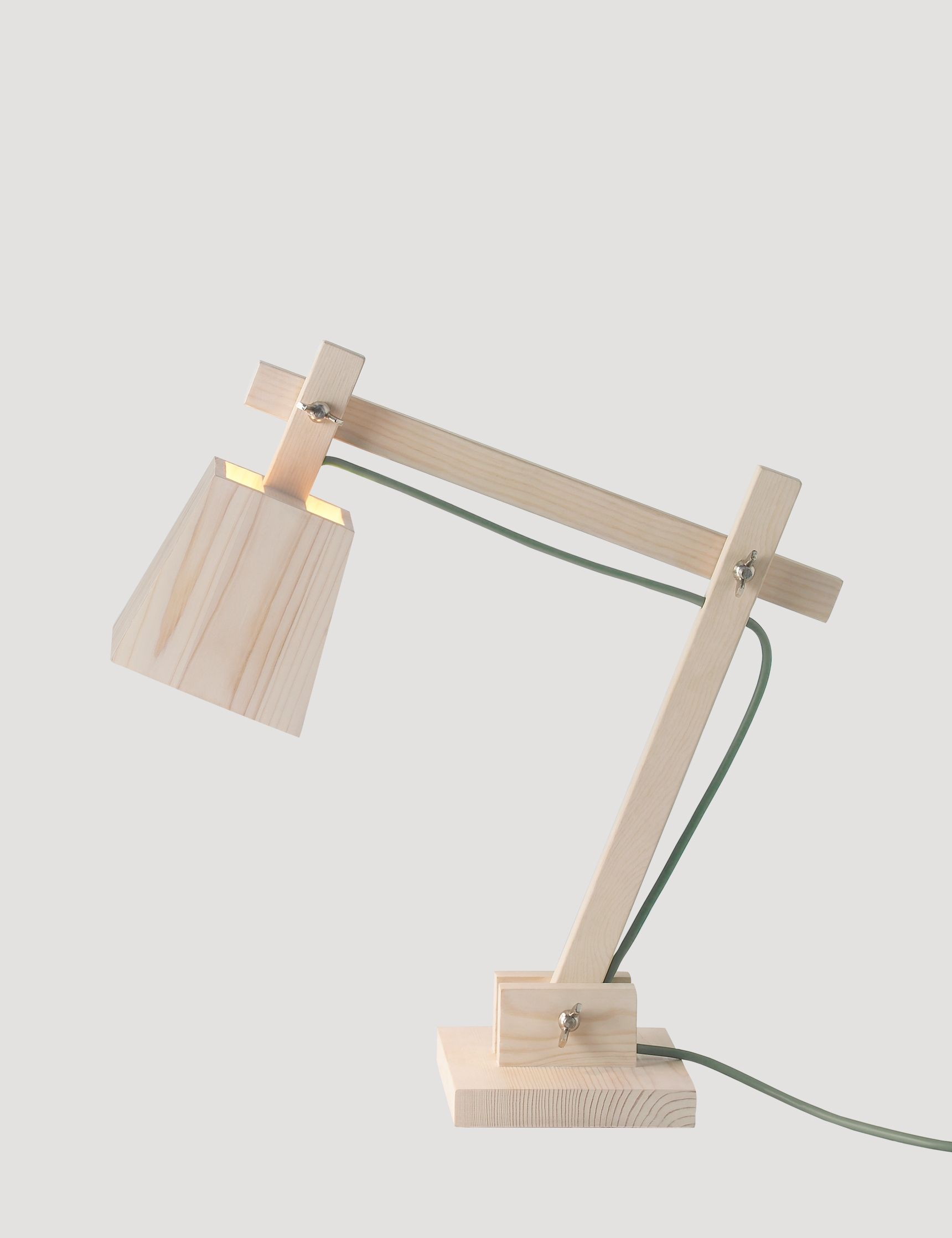 Designed by TAF Architects, the WOOD table lamp offers a contemporary, all-wooden interpretation of the traditional architect lamp. Here with a dusty green colored cord. #muuto #muutodesign