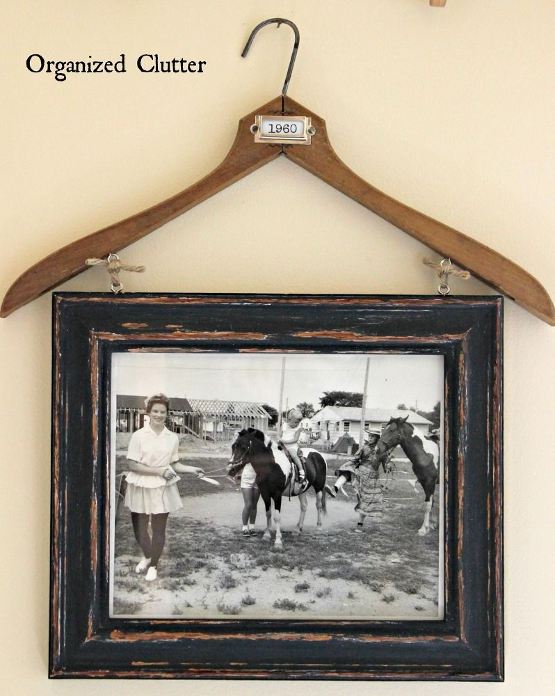 Vintage clothes hanger frame photo display clothes hanger a vintage clothes hanger a painted and distressed wooden frame and eye hooks come jeuxipadfo Gallery