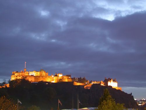 Edinburgh Castle lit up in the late day.
