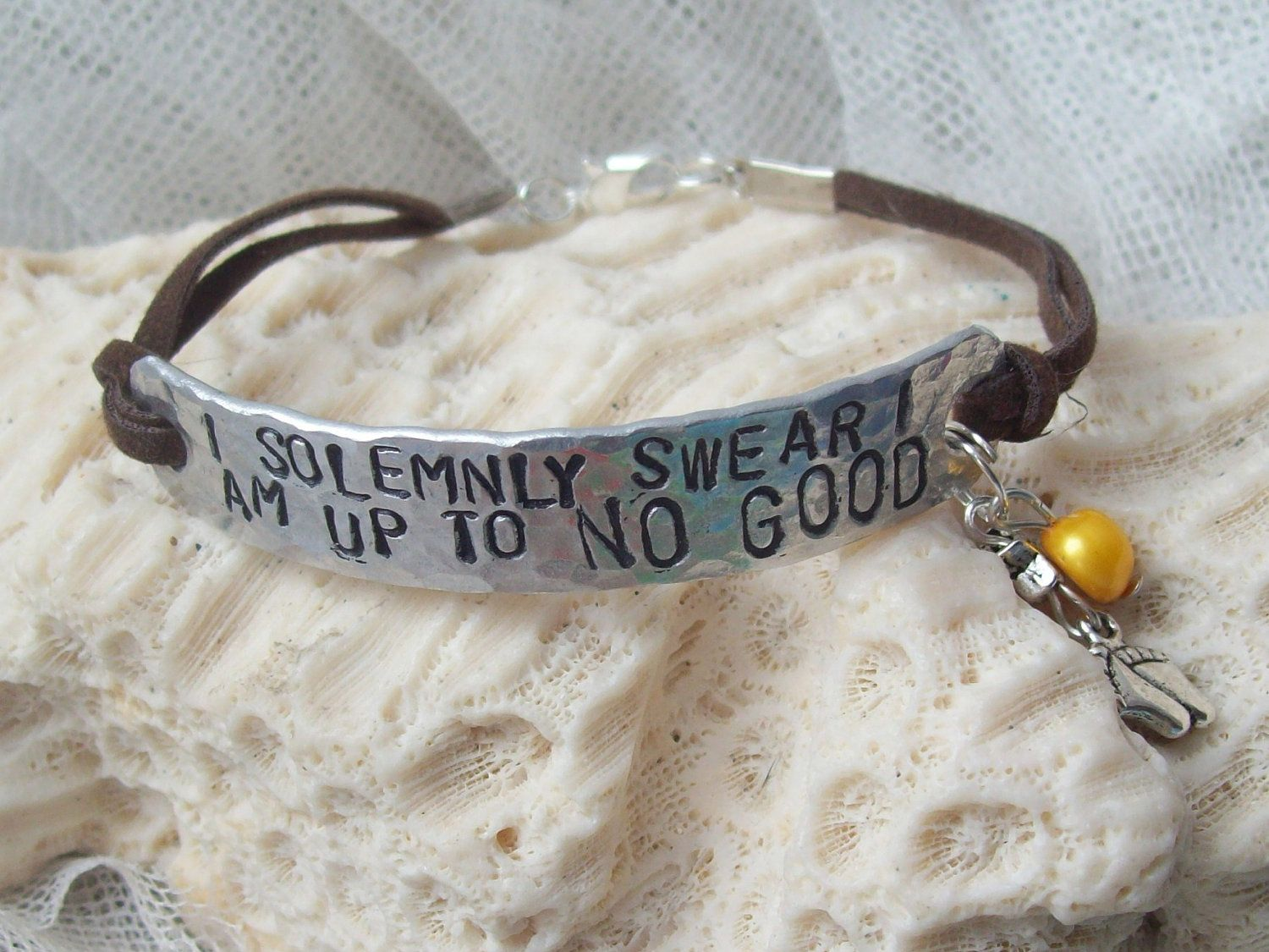 I SoLeMnLy SwEaR I aM uP tO nO GoOd - Wizard hand-stamped aluminum bracelet. $9.45, via Etsy.