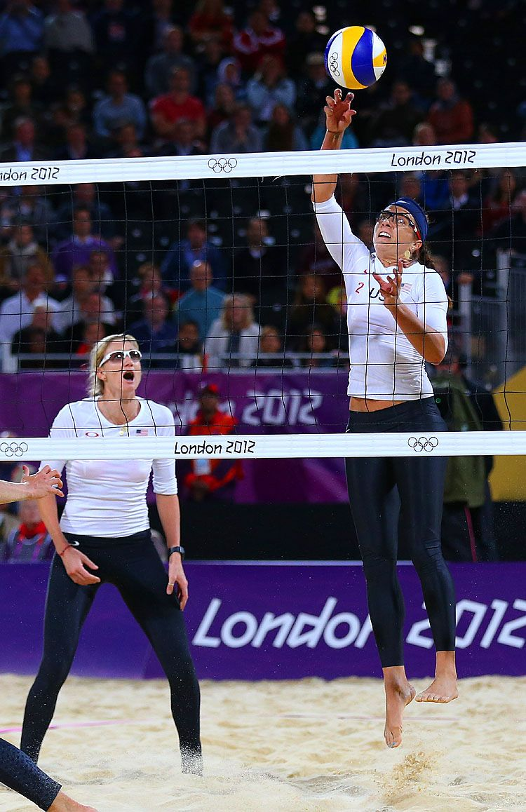 Misty May Treanor Of The United States Hits Over The Net During The Women S Beach Volleyball Preliminary Volleyball Photos Beach Volleyball Volleyball Articles