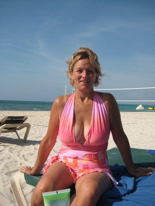 At Naked beach woman old
