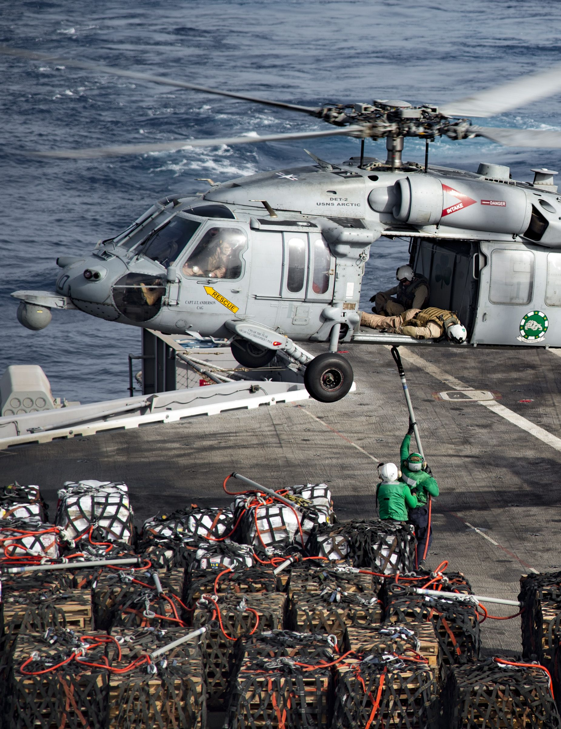 GULF OF OMAN (July 20, 2016) An MH-60S Sea Hawk helicopter assigned to the Dusty Dogs of Helicopter Sea Combat Squadron (HSC) 7 unloads cargo to the flight deck of the aircraft carrier USS Dwight D. Eisenhower (CVN 69) during a replenishment-at-sea with the fast-combat support ship USNS Arctic (T-AOE 8). Dwight D. Eisenhower and its Carrier Strike Group are deployed in support of Operation Inherent Resolve, maritime security operations and theater security cooperation efforts in U.S. 5th…