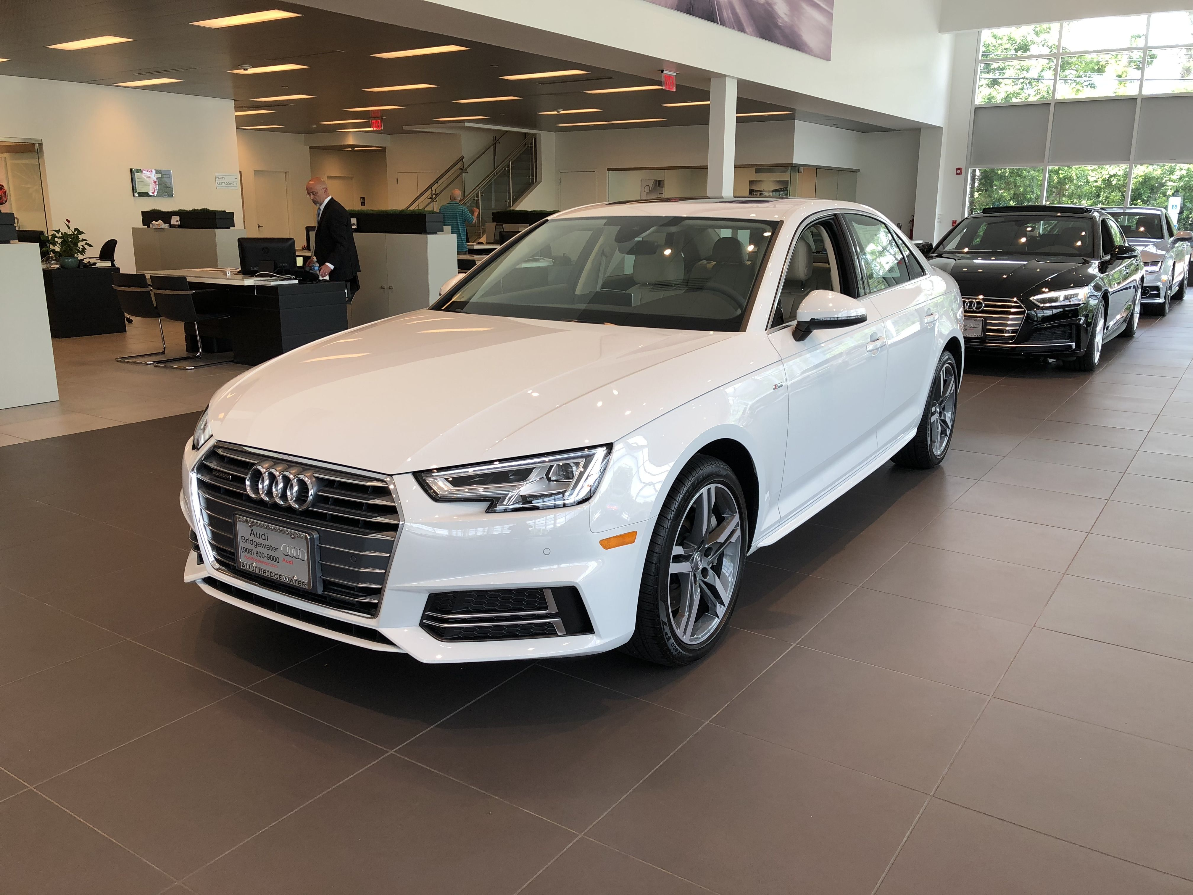 High Angled Side View Of Ibis White Audi A4 Located At Audi Of Bridgewater Nj Audi Dealership Audi Used Luxury Cars
