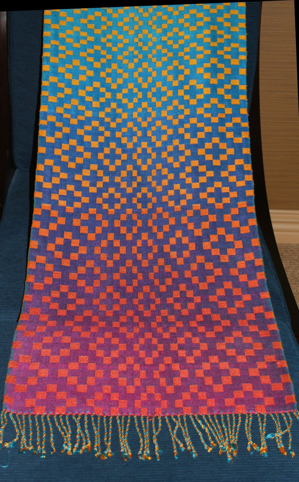 completed handwoven doubleweave shawl, blue/purple/fuchsia background