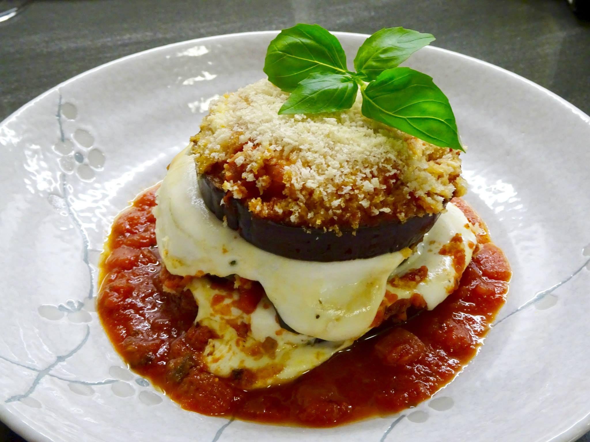 Eggplant Parm with smoked mozzarella, fresh basil, San Marzano tomato sauce and panko bread crumbs...... Never go light on the mozzarella.....