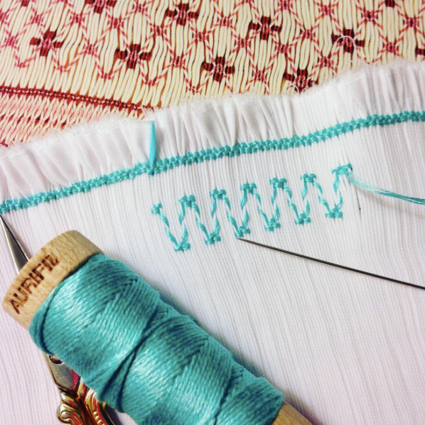 I absolutely adore this hand-smocking that Wendy of #IvorySpring did using #Aurifloss in Light Turquoise (#5006). She is working on a new outfit for her daughter and saw the holiday as a wonderful opportunity to make some progress.   To see more of Wendy's work, please visit: https://www.instagram.com/ivory_spring/  For a wonderful selection of our floss, check out Wendy's brand new Aurifil collection:  http://www.aurifil.com/marmalade-meadows
