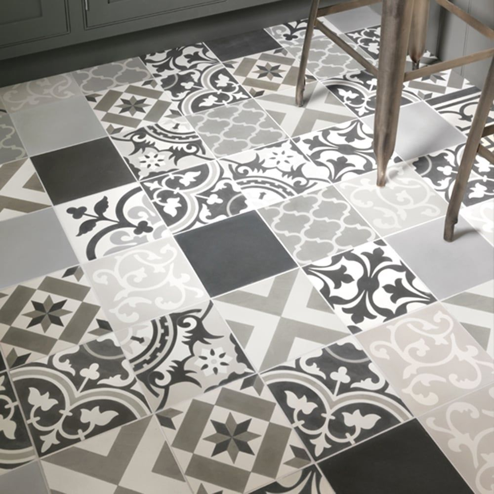 Cement Patchwork Grey tile by Ca'Pietra combines several different patterns together in a harmonious combination. The tiles vary from geometric to floral designs in tones of grey. A classic spanish feel. Tiles are handmade using natural materials and suitable for interior walls and floors.