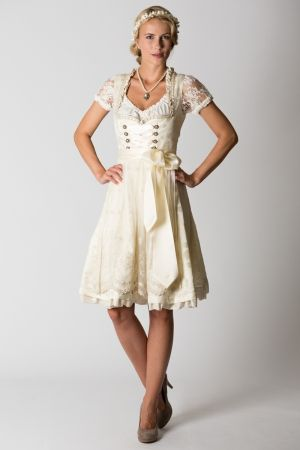Delivery includes: with apron, no blouse Colour: cream Pattern: floral Length of dress: 105 cm size EU 36/S Length of skirt: 65 cm Height of model: 174 cm Our model is wearing size: EU 34 Fit: regu...