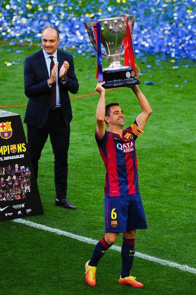 Xavi Hernandez of FC Barcelona lifts La Liga trophy at the end of the La Liga match between FC Barcelona and RC Deportivo de la Coruna at Camp Nou on May 23, 2015 in Barcelona, Catalonia.