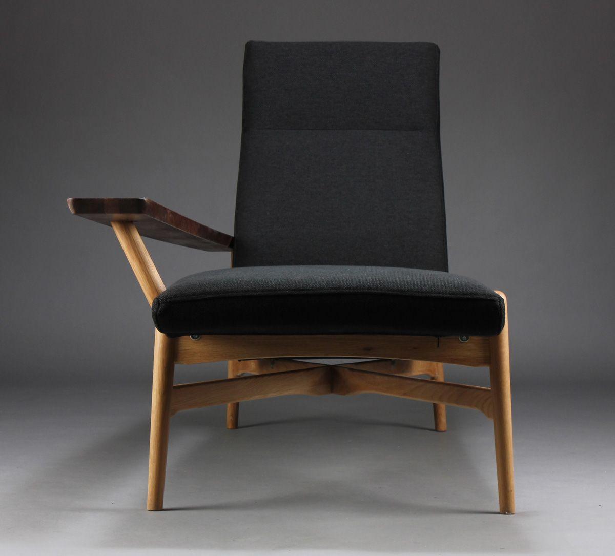 Chaise longueeasy chair crosslegged base oak and