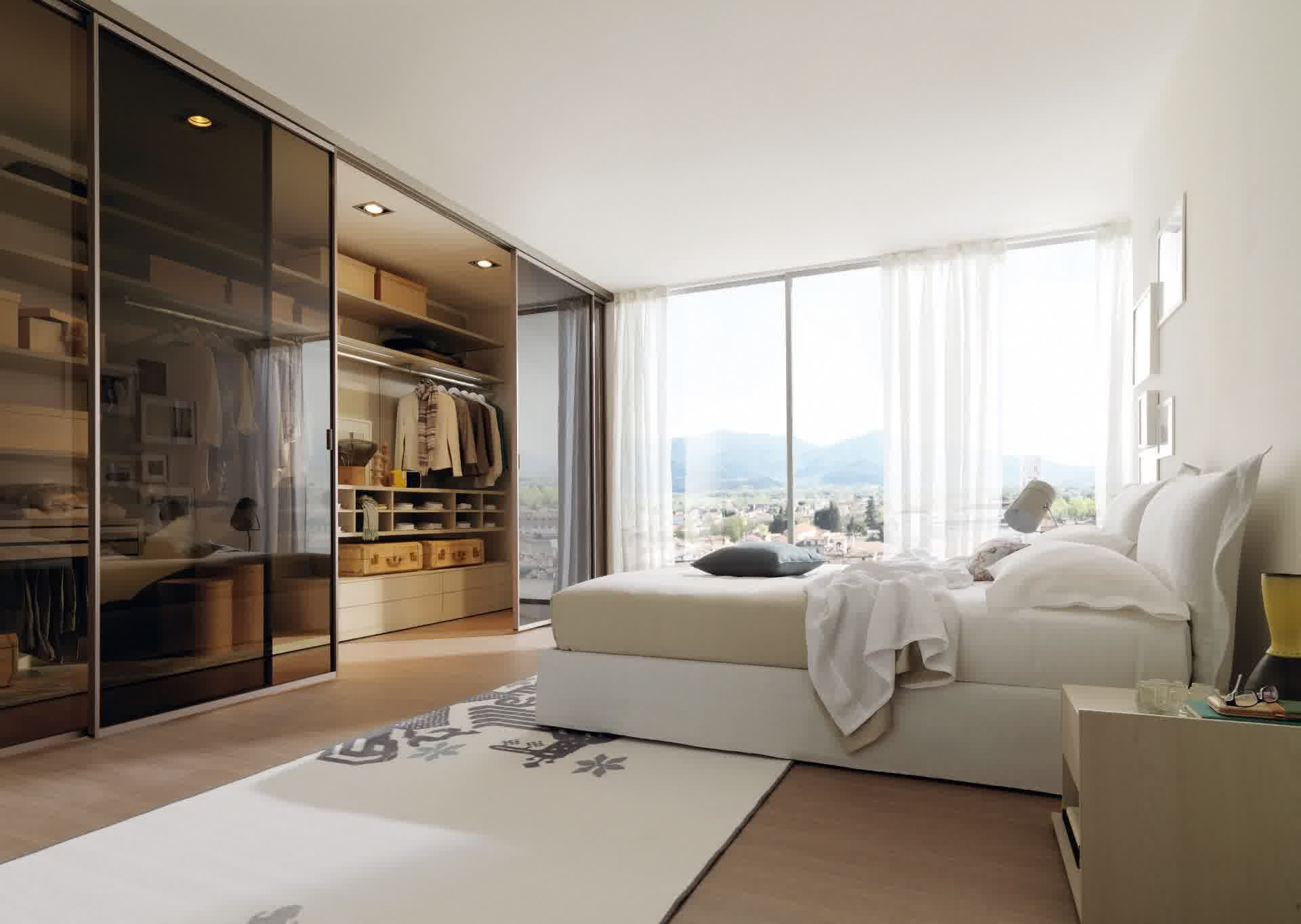 . Modern Master Bedroom Closet With Elegant White Curtains And Cozy