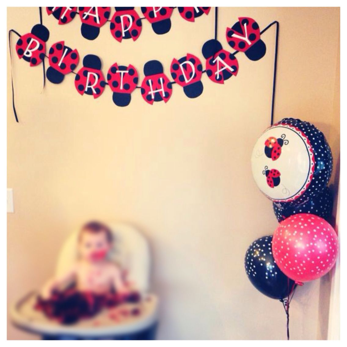 Ladybug birthday banner and balloons