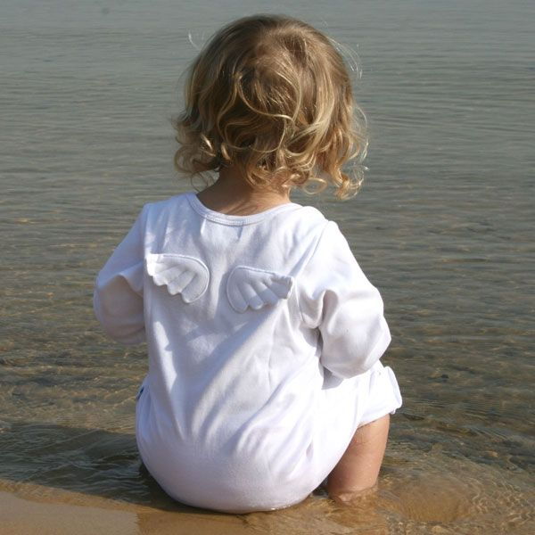 little one sitting by the shore