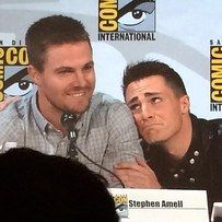 Stephen Amell (Oliver Queen/Green Arrow) and Colton Haynes (Roi Harper/SPOILER! Red Arrow) at Comic Con 2014