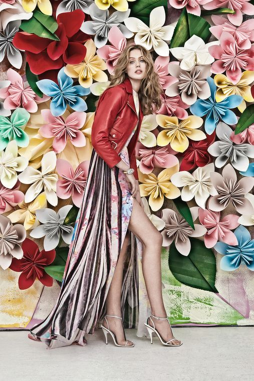 Colourful paper flowers create an amazing backdrop