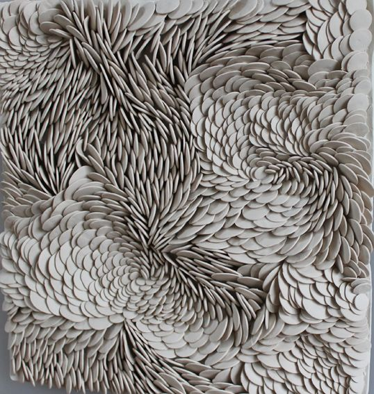 "Fenella Elms - Ceramics Artist - Flows  ""Mounted for wall hanging, these works are intuitively built in porcelain clay to create shifting perspectives.  Individually made beads of clay joined to a sheet of porcelain with slip before the whole work is fired together to make one, single piece."""
