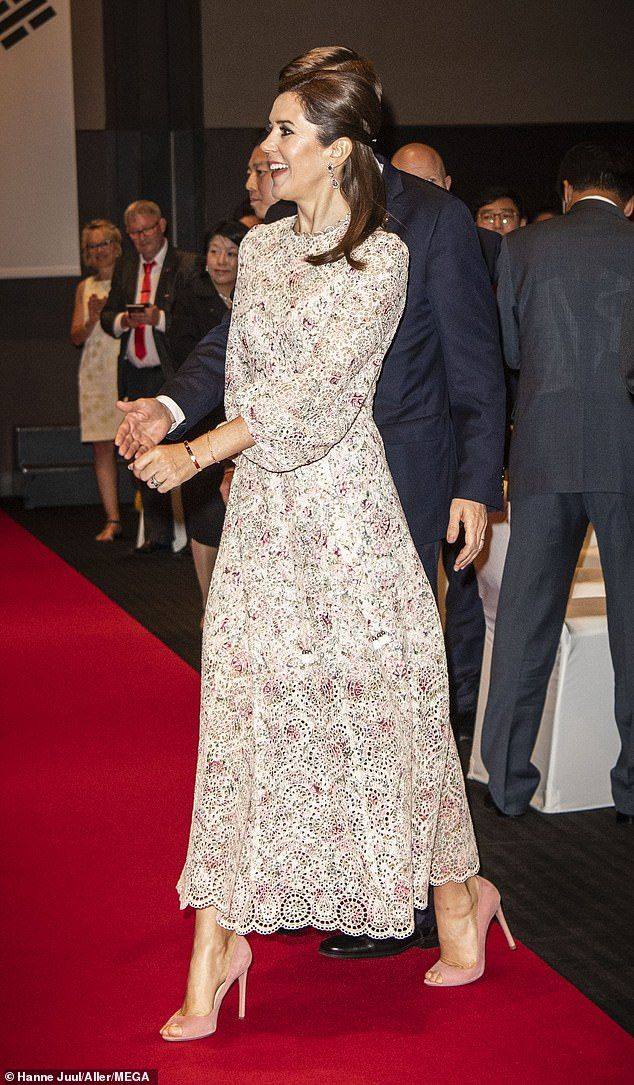 Crown Princess Mary opts for a white trouser suit at a cooking show