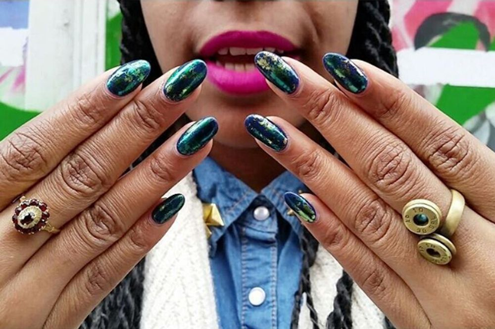 Try not to be obsessed with her cutting edge, minimalist nail designs!