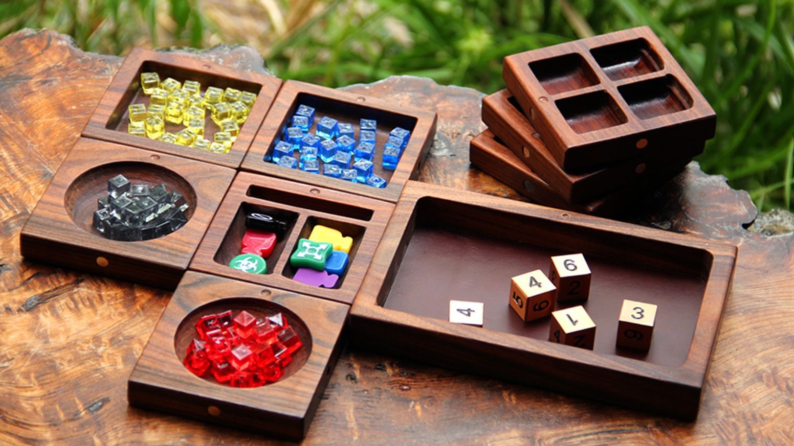 A modular tile system for organizing board game tokens and