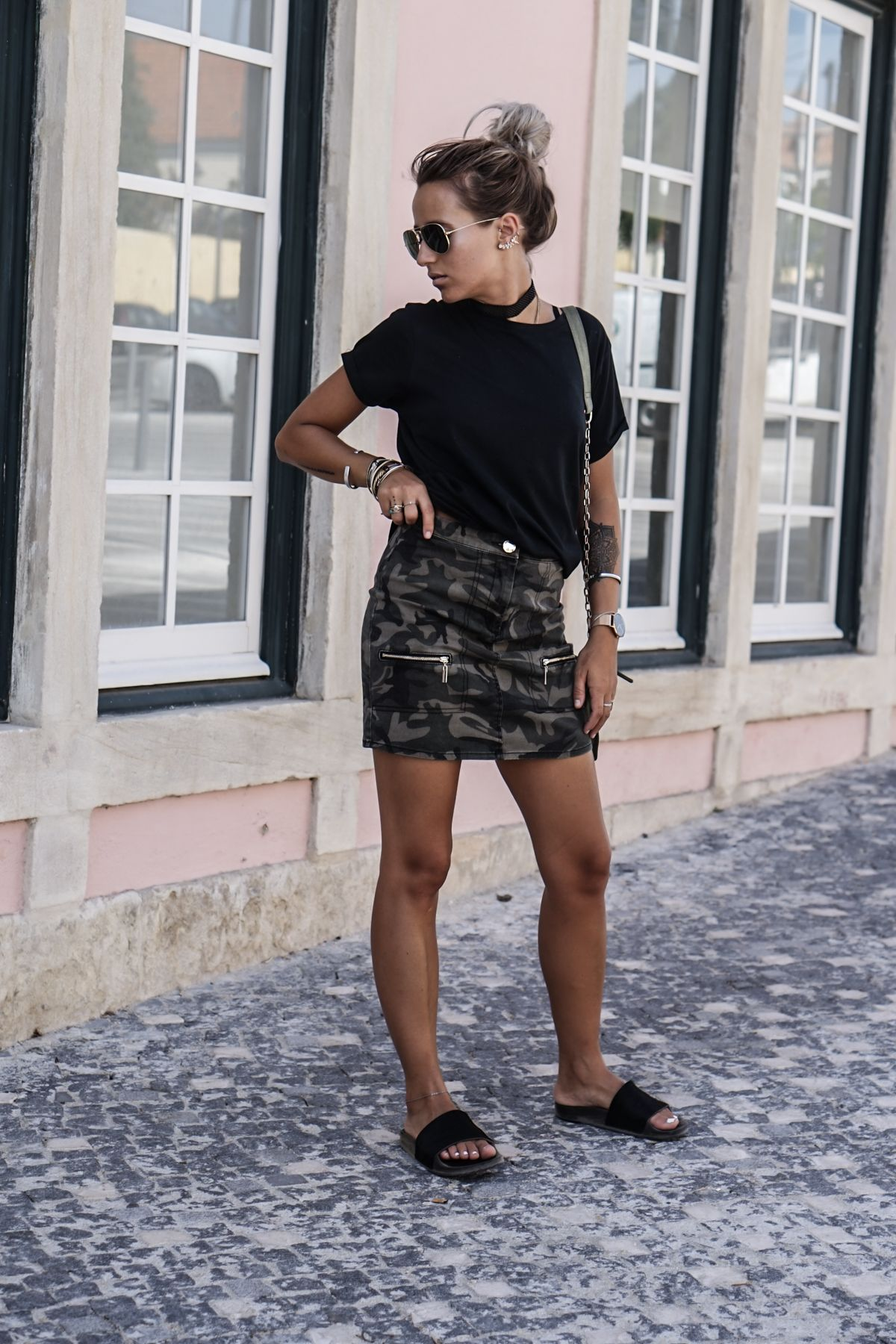 21e82bda72729 There are a hundred great ways to wear the mini skirt trend. Camille Callen  is edgy and original in this camo print skirt with zip detailing, paired  simply ...