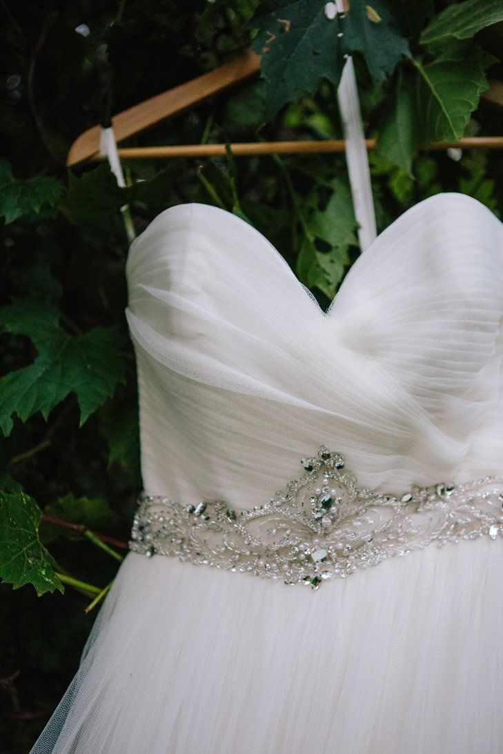 A-line tulle gown featuring a ruched bodice with an ornate jewel ...