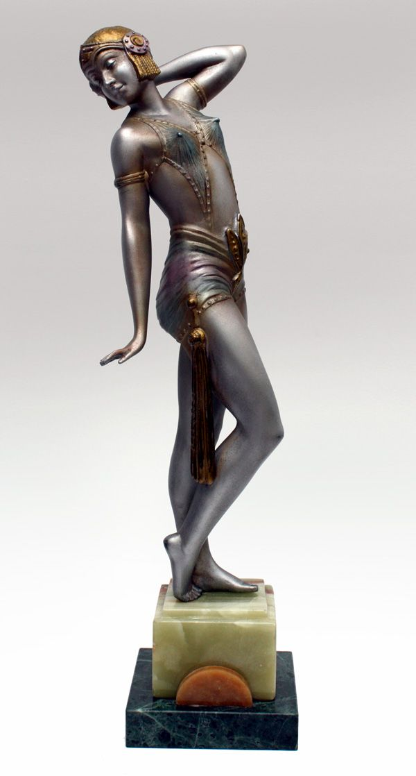 Art Deco spelter figure by A LECLERC, France ca. 1930, the silver cold-painted figure with polychrome decoration, mounted on a multi-coloured marble base. Metal marked A. Leclerc. H. 37 cm (hva)