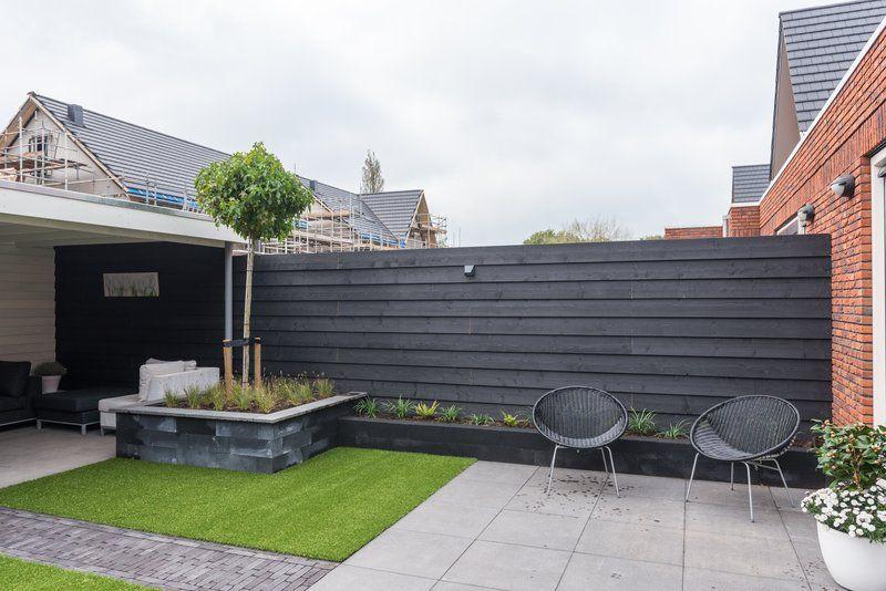 deze schitterende luxe tuin met veranda kunstgras en in