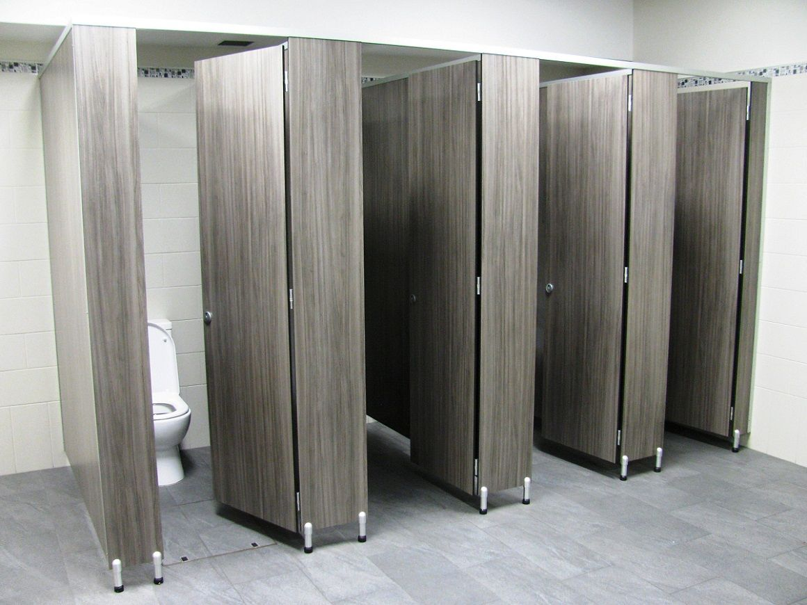 Male Toilet Partitions With Special 100mm Leg In A Timber Grain