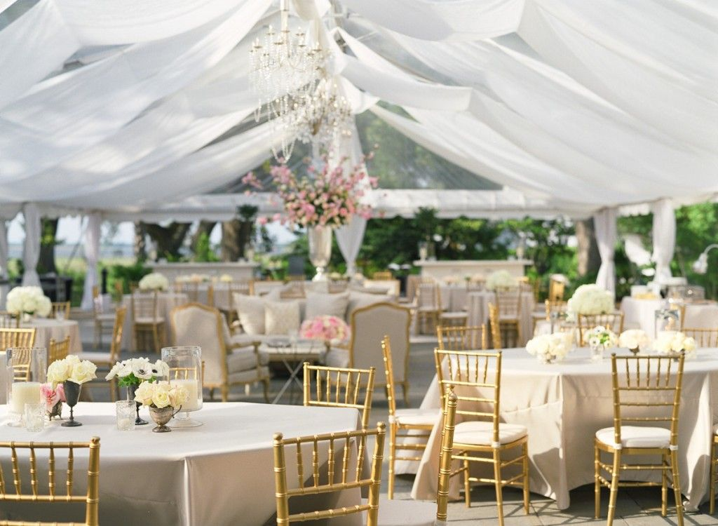 afternoon tewedding theme ideas%0A tent wedding decor  This lightandairy look with minimal decoration  gold  chivari chairs  one major centerpiece in a silver urn  is ideal for a  daytime