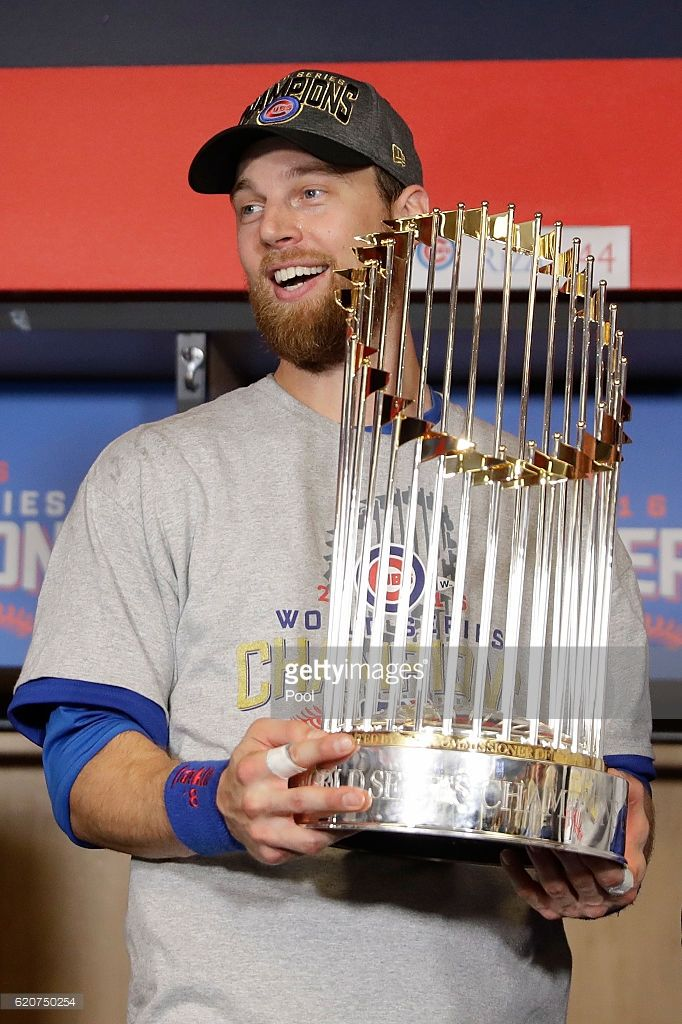 b6d864738 World Series MVP Ben Zobrist  18 of the Chicago Cubs poses with The  Commissioner s Trophy after the Chicago Cubs defeated the Cleveland Indians  8-7 in Game ...
