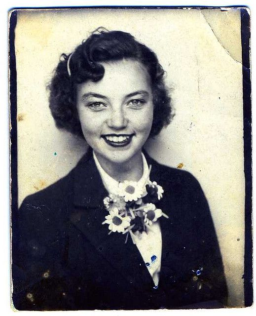Anonymous young woman with a great smile and a daisy corsage.