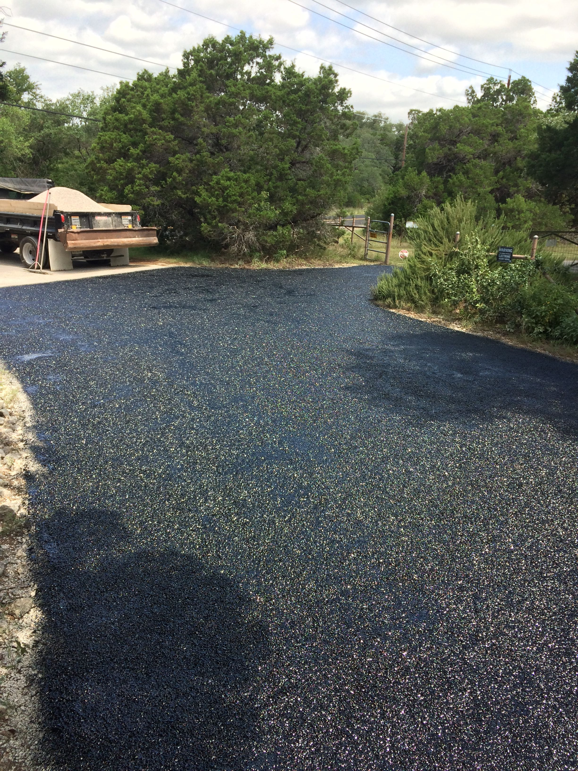 This Driveway Has Been Sprayed With Hot Rubber Tar And Next Crushed Stone Will Be Applied To Create A Chip And Seal Driveway Crushed Stone Paving Leander