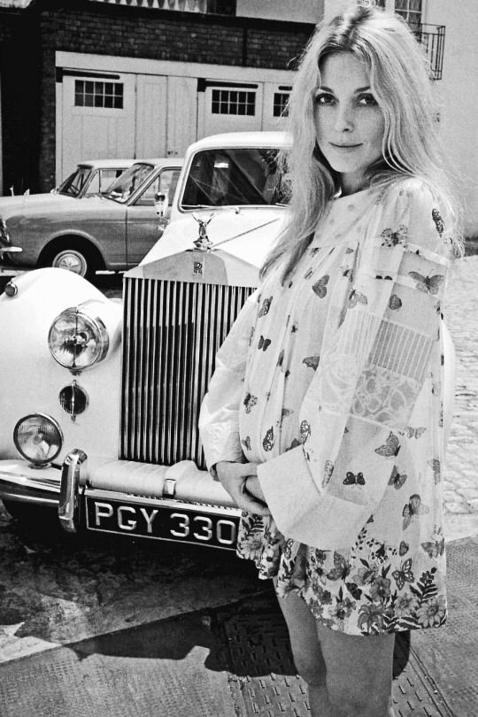 Sharon Tate, wearing her butterfly-print Pucci dress while being photographed by Terry O'Neill at her London home, shortly before she returned to the USA in 1969