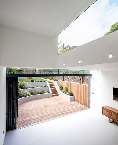 Angel house  sutton construction sunken patio garden terraced basement studio also best doors images in exterior design future gardens rh pinterest