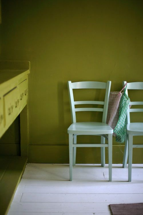 I love this deep Citrine green from Little Greene for the walls and traditional Victorian dresser in what was the house's original kitchen. The junk chairs are painted in Farrow & Ball's Pale Powder eggshell.