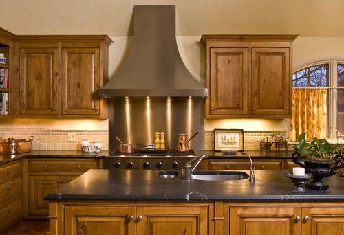 Knotty Alder Cabinets With Black Countertops Light Colored Backsplash Country Kitchen Designs Alder Kitchen Cabinets Elegant Kitchen Decor