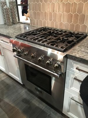 """Best of #KBIS2015: Thermador's Five Burner Pro Harmony Range / cooking appliance   Carla Aston from Modenus' #BlogTourVegas   Image via: Thermador.com - no need for clearance in the back of this 30"""" range. Can push it right up against the tiled wall."""