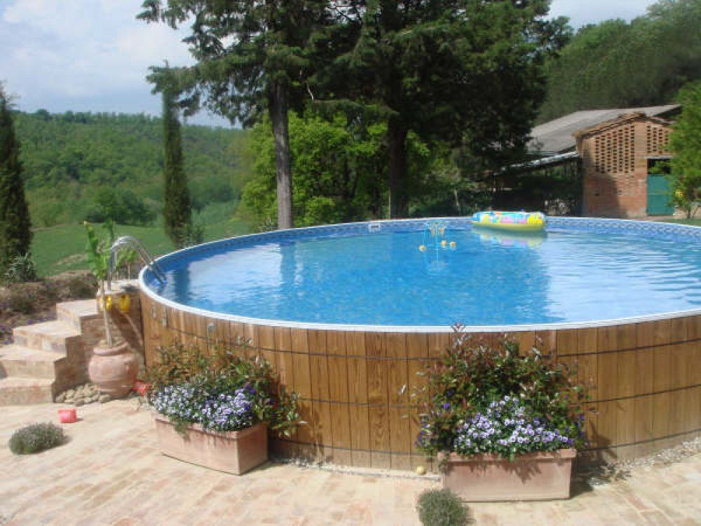 Placing flower boxes around your above ground pool walls for Pool landscapes ideas pictures