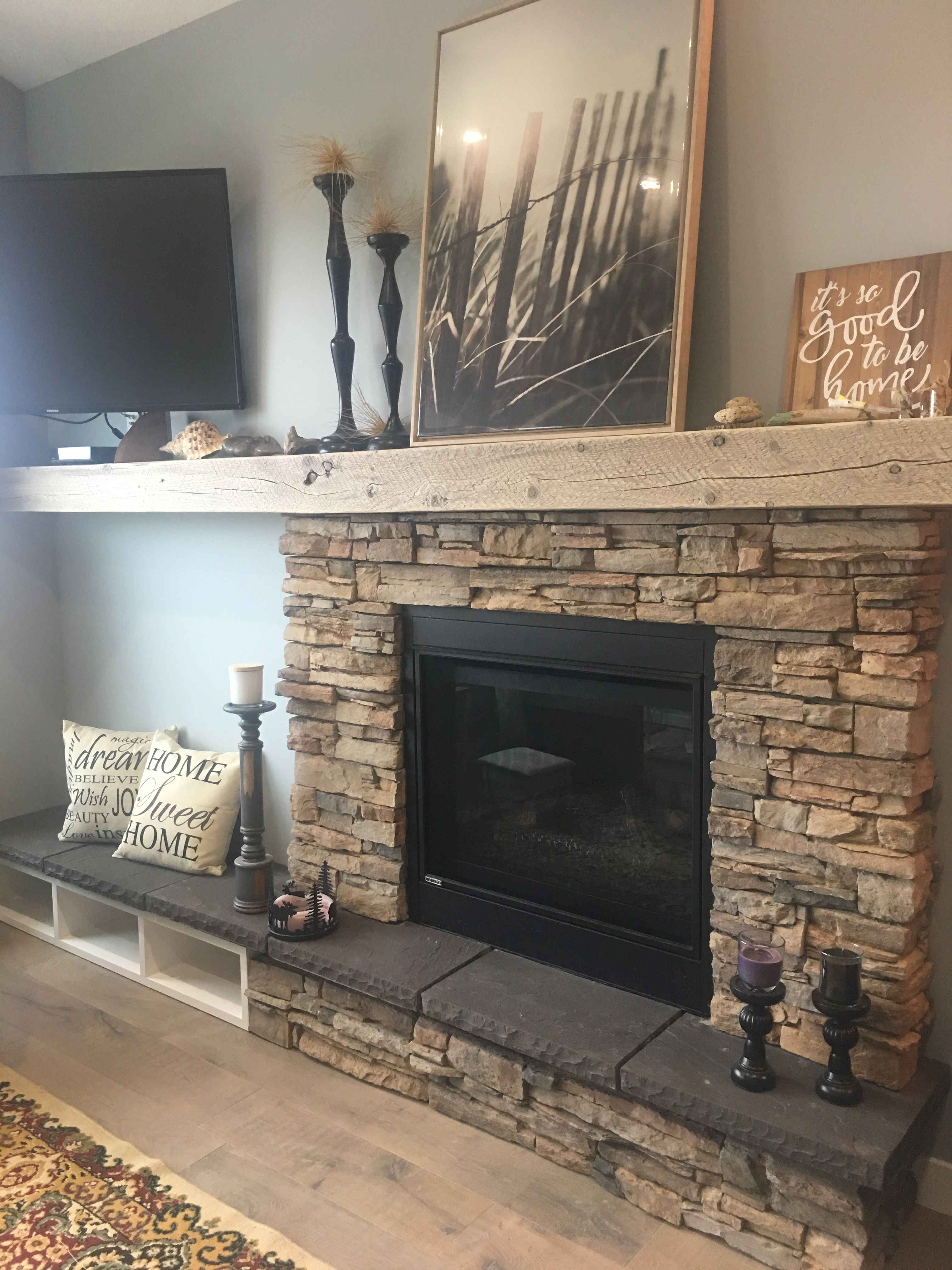 The Placement Of The Decorations Makes This Fireplace Asymmetrical
