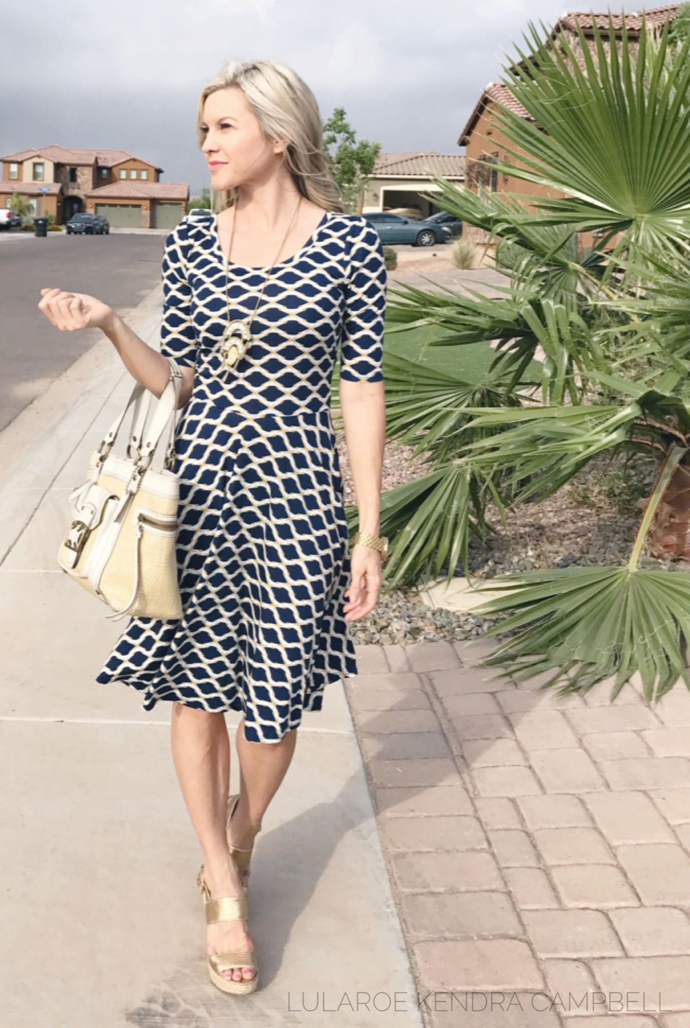 c18d2a9f52b The LuLaRoe Nicole dress is effortless and feminine! Click to shop LuLaRoe  and for more styling ideas and giveaways.