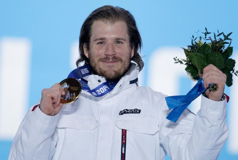 DAY 10:  Gold medalist Kjetil Jansrud of Norway celebrates on the podium during the medal ceremony for the Alpine Skiing Men's Super-G http://sports.yahoo.com/olympics