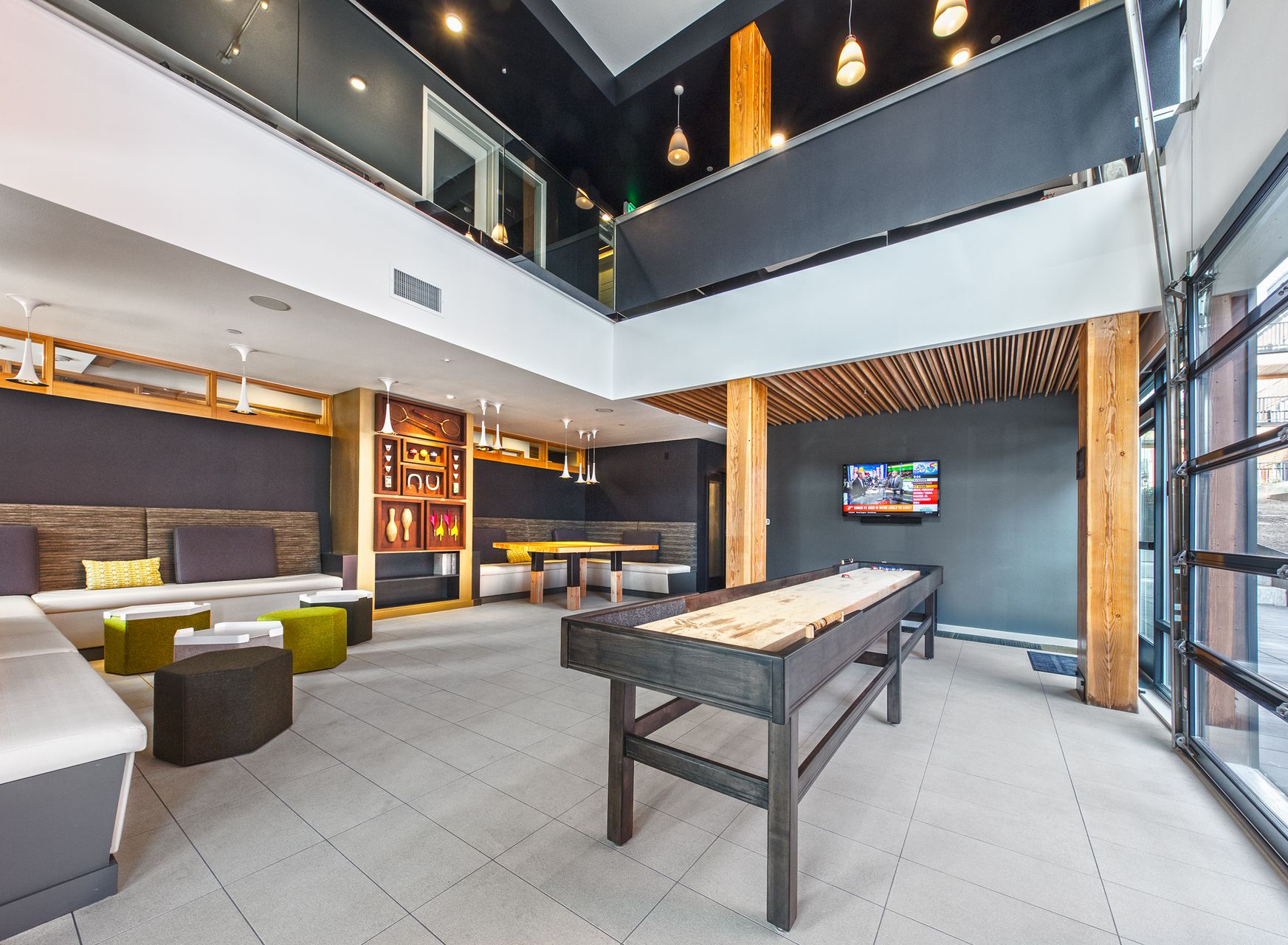 The club room has a shuffleboard and garage doors able to