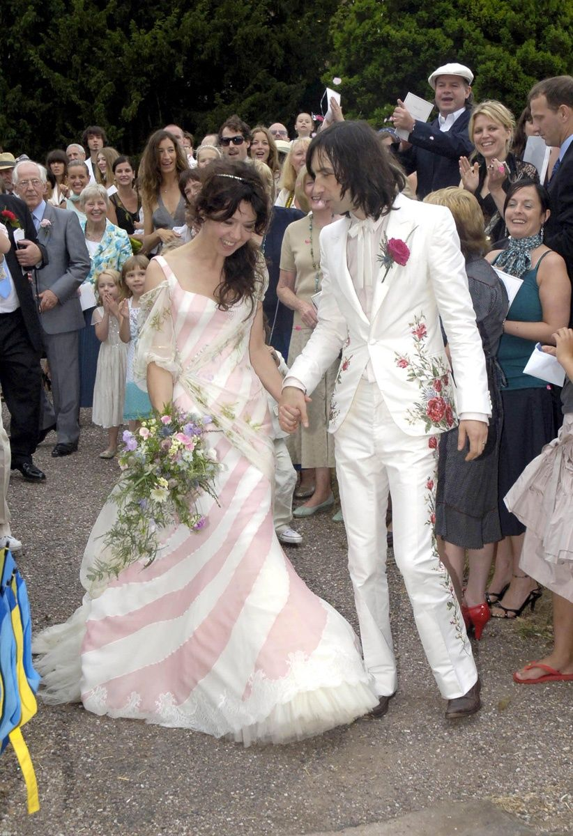 Stylist Katy England's candy-stripe McQueen dress kept the focus on her during her wedding to Primal Scream's front man, Bobby Gillespie on July 29, 2006.