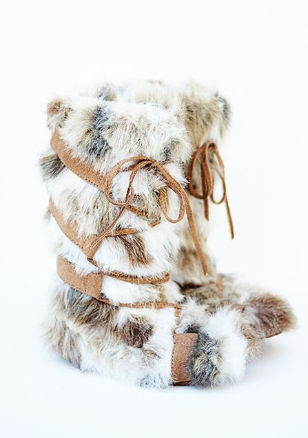 b6246d9413e5 Zoe in Cream RV  82 These outrageously furry boots are made of luxurious  and soft faux rabbit fur. They feature tan micro suede straps that lace  almost to ...
