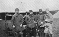 Left to Right, Frazier Curtis, Jimmie Bach, Bert Hall and Norman Prince at Pau military flight school March 1915. A 'penguin' training plane is in the background.