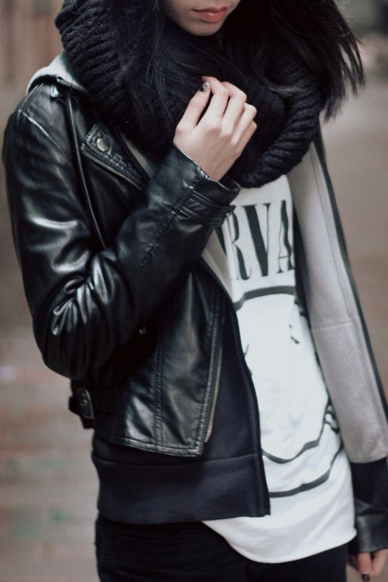 Black leather jacket layered casually